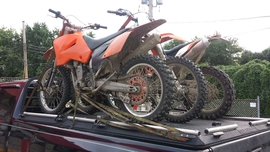 Motorcycles Loaded On A Heavy Duty Truck Bed Cover Of A