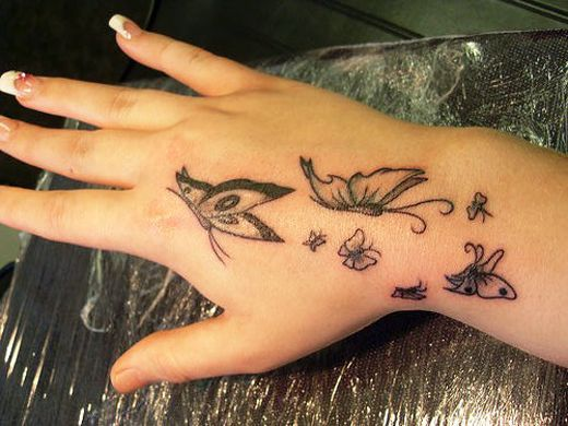 Black Butterflies Hand Tattoo Design