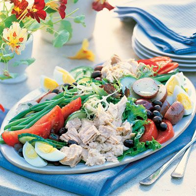 This classic French composed salad — with its hard-boiled eggs, baby red potatoes, olives and tuna — is the perfect entrée for a ladies' lunch or light dinner. Recipe: Salad Niçoise   - Delish.com