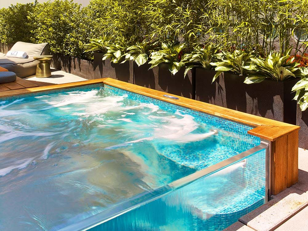 Stainless Steel Spa With Clear Vinyl Front Skirt And Clear Bottom Foot Well With Water Spill Over Water Feature And Auto Cover 1 Glass Pool Swimming Pools Pool