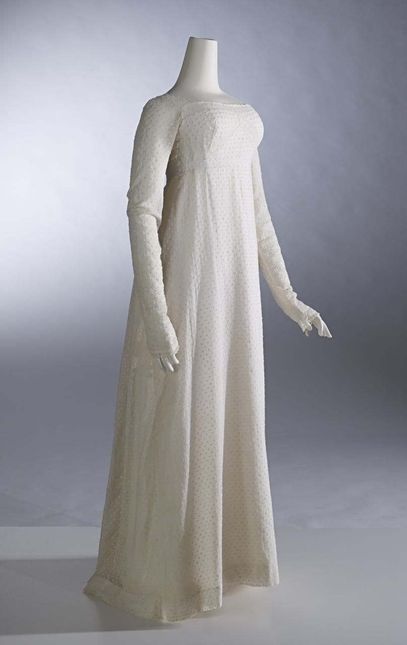 Dress (c. 1809) (ENGLAND) Medium hand-embroidered cotton muslin, cotton (bobbin lace), shell (button), linen tape Place/s of Execution (England) Accession Number D110-1974