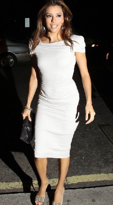 Eva Longoria in Victoria Beckham Spring 2010 dress, Ferragamo sandals and clutch, September 2010