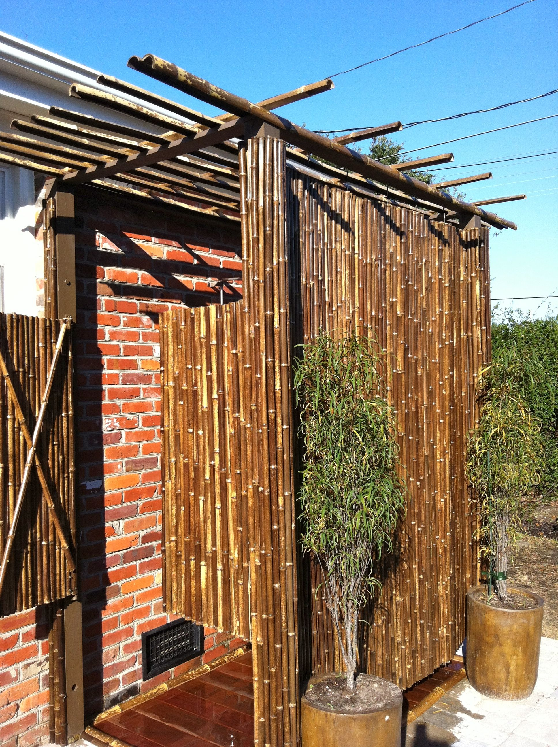 Outdoor shower made with Cali Bamboo black fencing