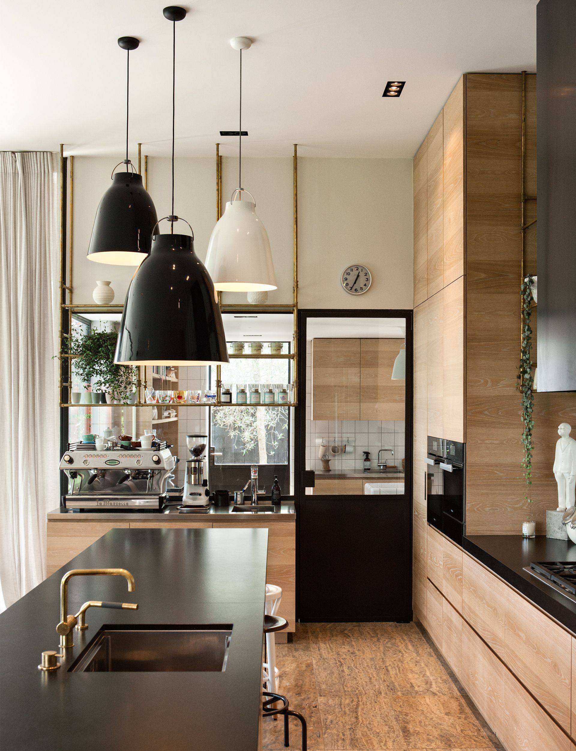 Walnut Cabinets With Dark Stainless Steel Countertops  A Luxury