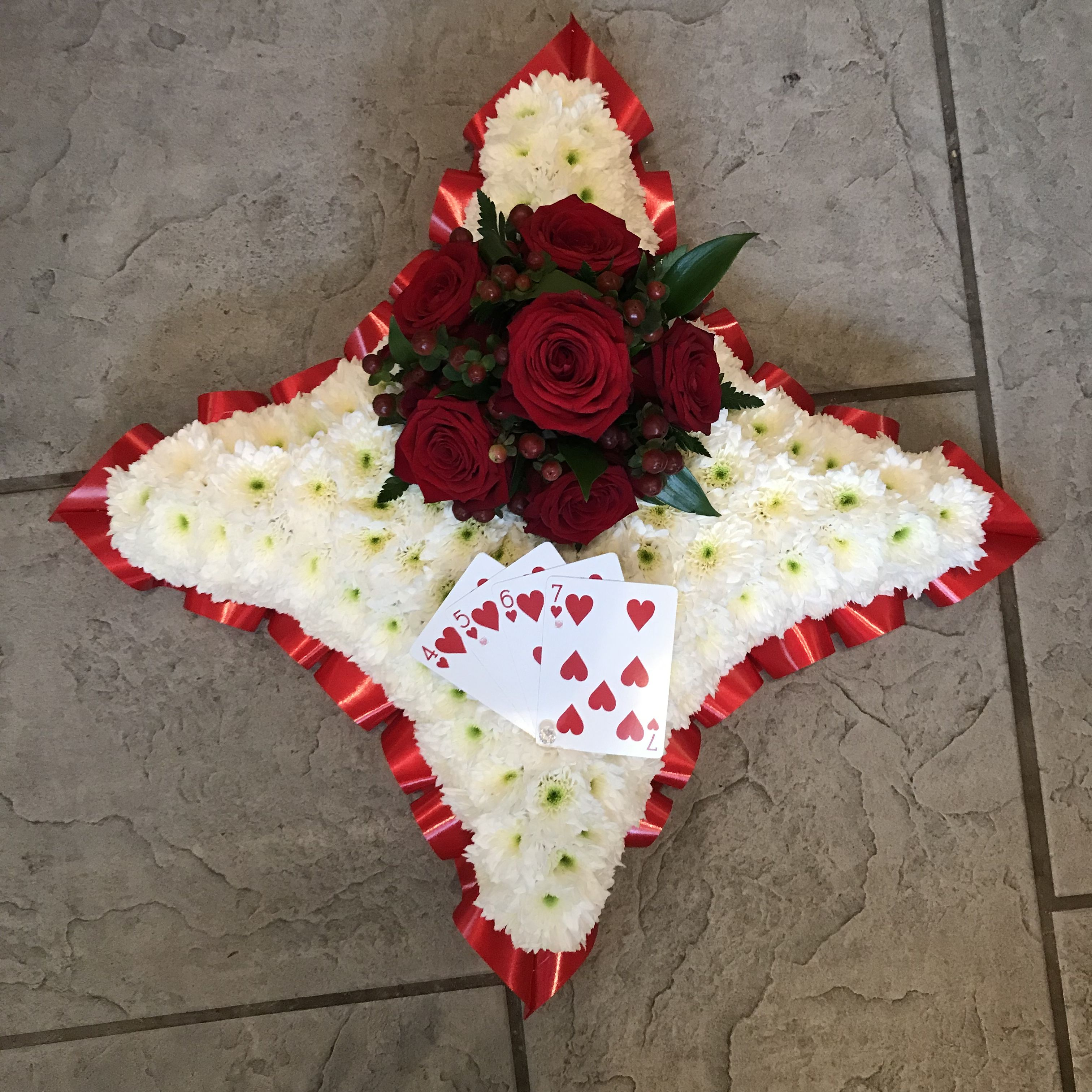 Red and white cushion design funeral tribute with red rose spray and experienced freelance florist working from a private studio in gravesend kent specialising in fresh flower arrangements for funerals and weddings offering izmirmasajfo Choice Image