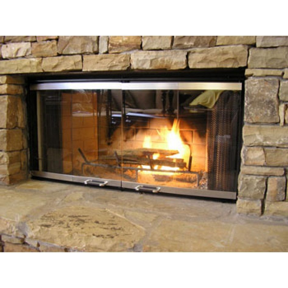Furniture Traditional Double Glass Fireplace Doors At Stone Wall