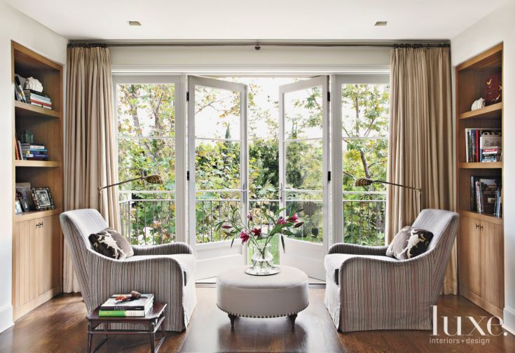 Mediterranean Neutral Bedroom Seating Area with Balcony