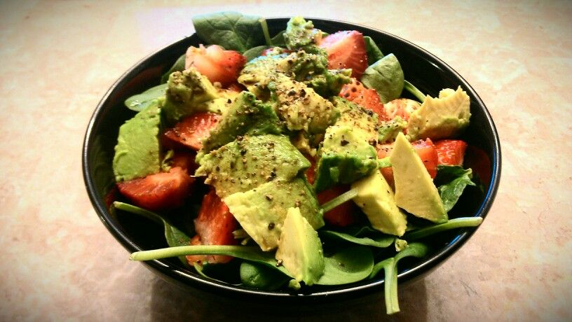 Hearty delicious spinach salad - baby spinach, cut up avocado, diced fresh strawberries, balsamic vinegar, crushed black pepper, and salt