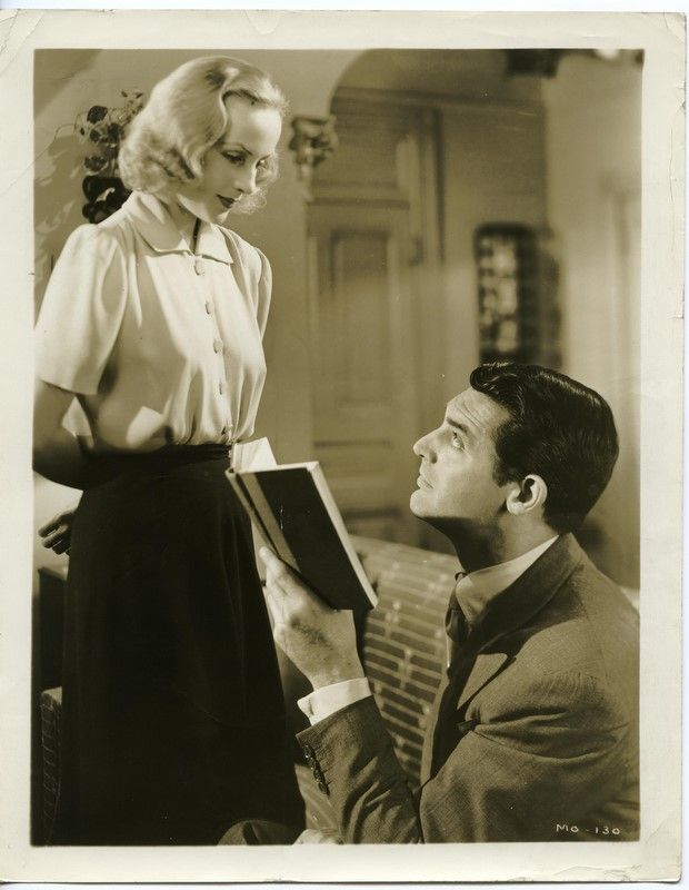 Cary Grant interrupted while reading by Carole Lombard. In Name Only (1939). While out riding in the country, wealthy and unhappily married New Yorker Alec Walker (Grant) meets intelligent young widow Julie Eden (Lombard), and a relationship quickly develops. His bitchy and manipulative wife Maida (Kay Francis) makes life miserable for all involved.