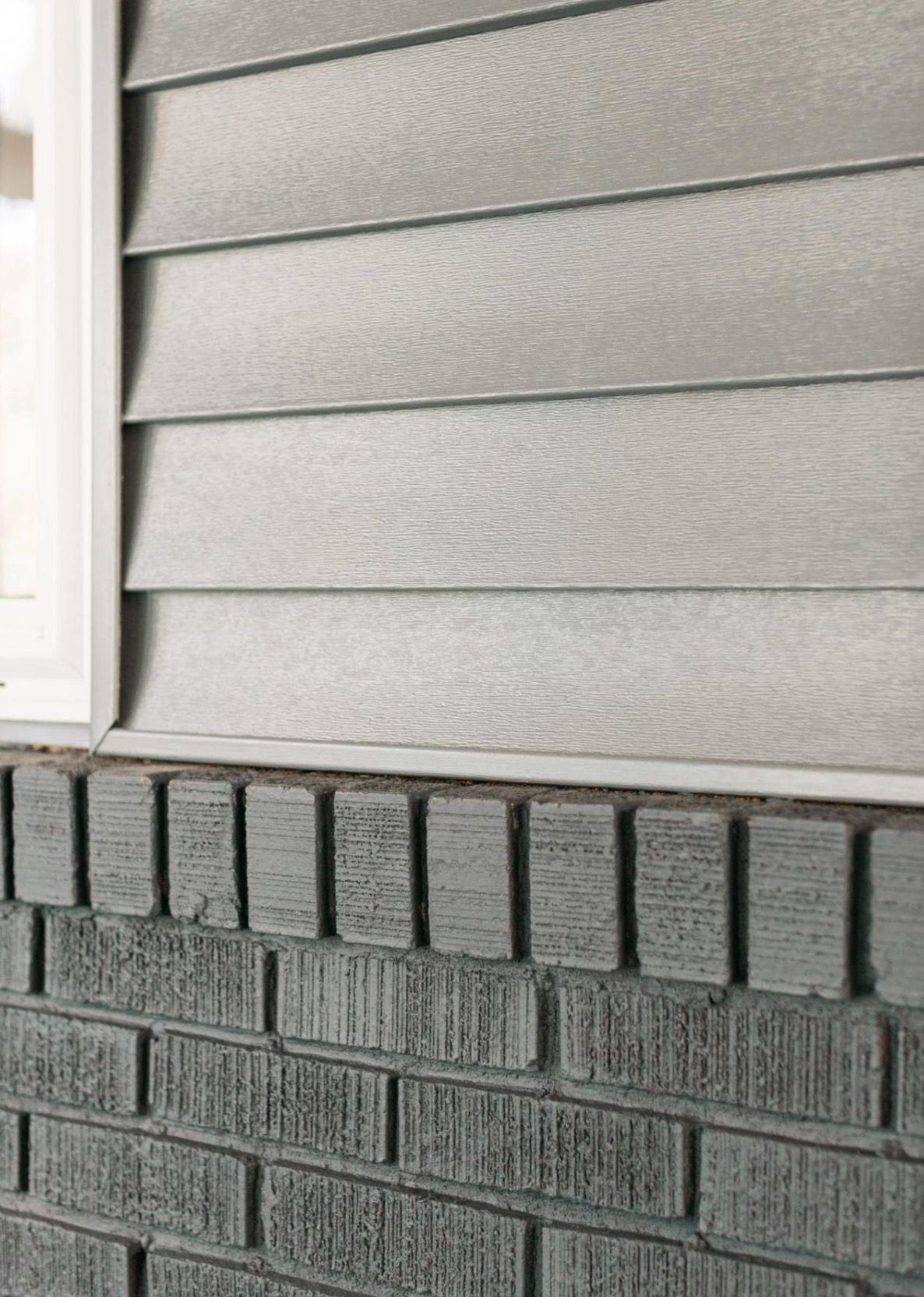 Grey Exterior Siding With Dark Grey Stained Brick