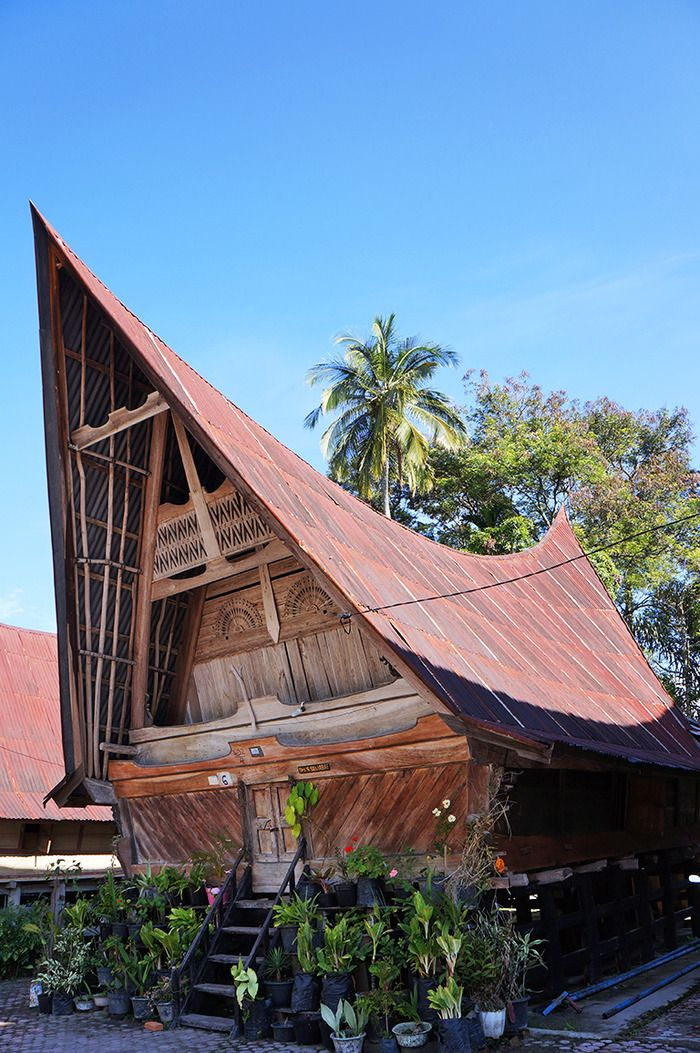 Batak Toba House Is Boat Shaped With Beautifully Carved Gables And Sweeping Ridges The Pillars At The Bottom Section Indonesia Building Exterior Architecture
