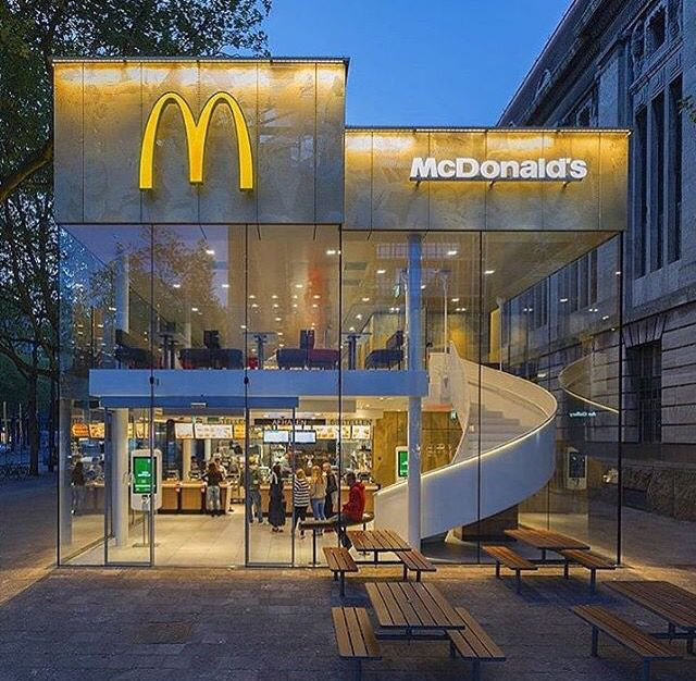 McDonalds Restaurant Has A Golden Facade And Spiral Staircase - Camouflaged into its surroundings mcdonalds restaurant by mei architects