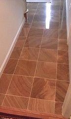 Tile flooring made to look like hardwood flooring.  Neat idea.