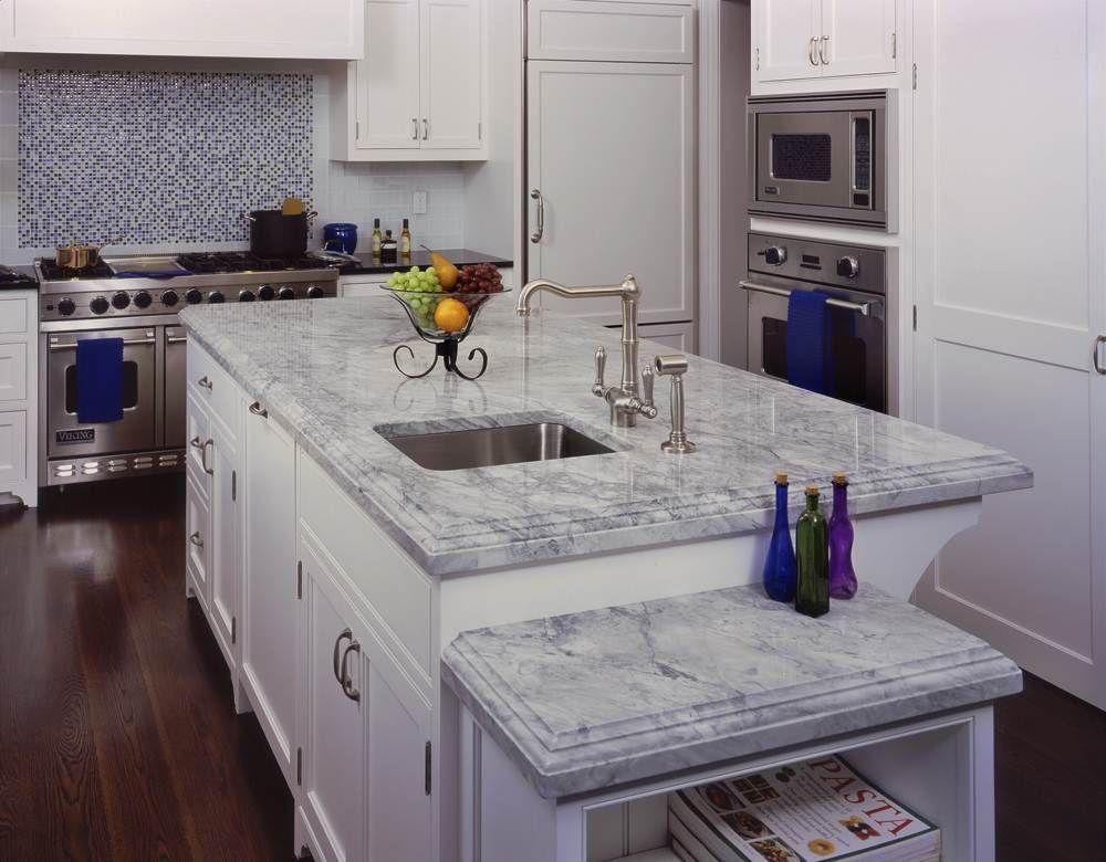 8 Popular Countertop Materials The Pros And The Cons White Quartzite Kitchen Super White Quartzite White Kitchen Decor