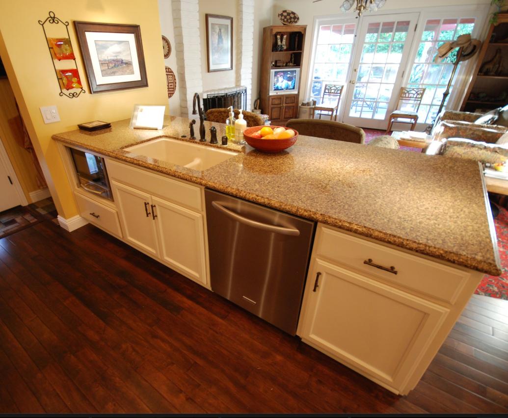 KraftMaid Bisque Glaze Cabinets With Cambria Brownhill Quartz Countertops.