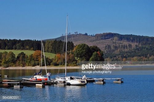 Boats at a pier on lake Diemelsee, situated in a Nature Park on... #diemelsee: Boats at a pier on lake Diemelsee, situated in a… #diemelsee