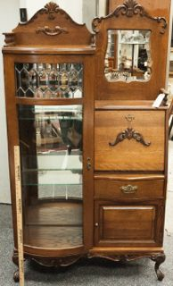 FURNITURE VINTAGE OAK SECRETARY DESK WITH GLASS CURIO CABINET. THE CABINET  FEATURES BEVELED GLASS DETAILS