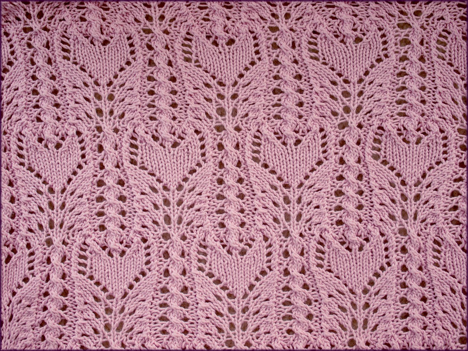 Ffct wrap knitting pattern this features tulip lace flowers ffct wrap knitting pattern this features tulip lace flowers topping tightly cabled stems and set bankloansurffo Gallery