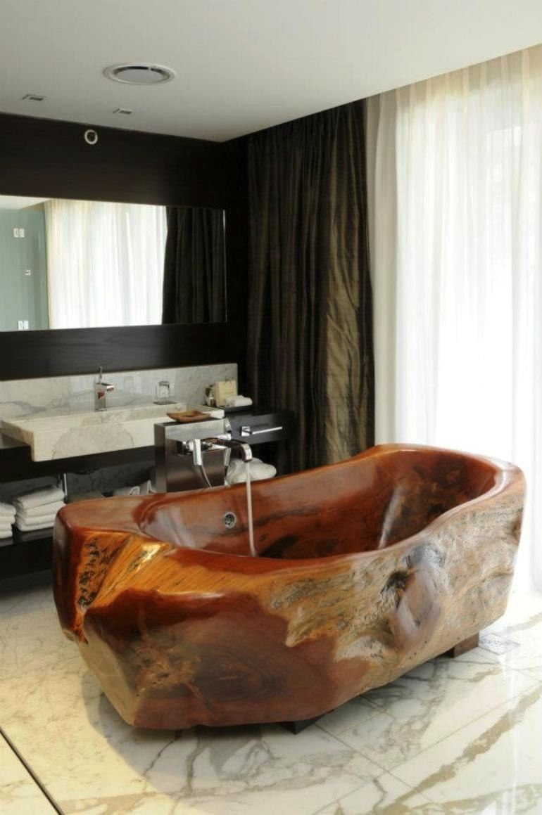 ..and in our final salute to nature in the bathroom, a highly unusual tub carved by artist Mario Dasso from a single tree felled by natural causes. Located in Mio Buenos Aires luxury hotel, it is our only tub in this set from Argentina. The video below shows how the hotel's tubs were hand crafted. The interiors of the hotel were designed by Beasley & Henley Interior Design of Florida, U.S.A.