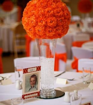 Beautiful Orange Wedding Table Centrepieces Also Love The Table Numbers Orange Wedding Flowers Flower Centerpieces Wedding Beautiful Wedding Flowers