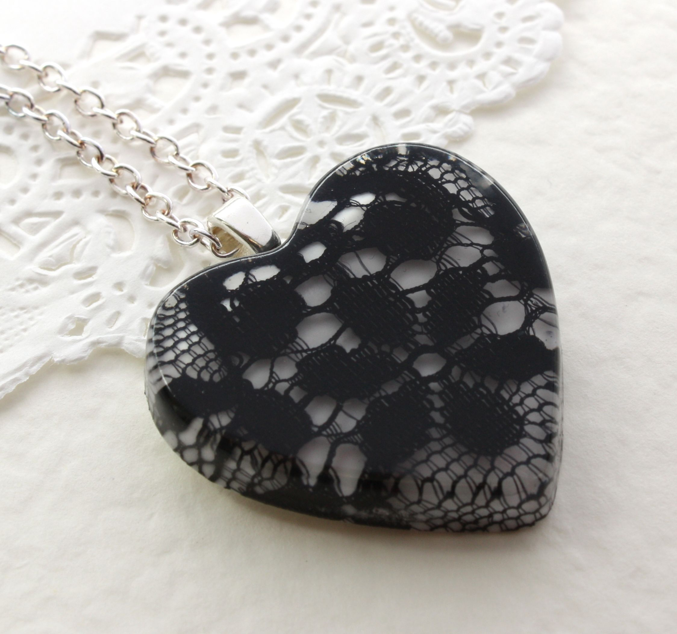 Black lace embedded in resin