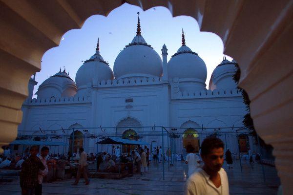 ALIGARH, India - The Upper Court City mosque, near sundown, with faithfuls milling around.