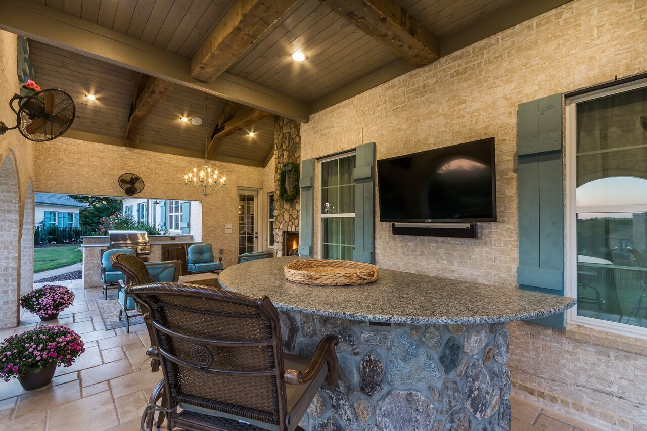 Outdoor Living Room With Tongue And Groove Ceiling Big Cedar Deco Beams Bar Area And Outdoor Kitchen Outdoor Living Room Outdoor Living Patio Design