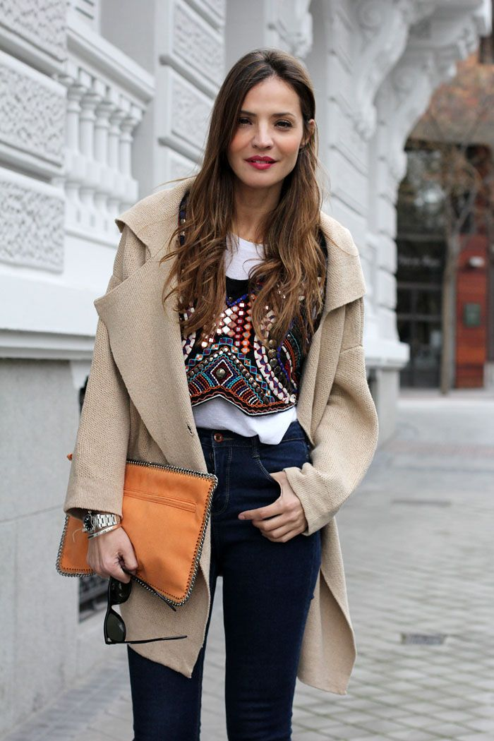 ethnic top over a white tee + great accessories