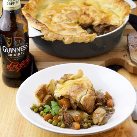A drunken Guinness pie filled with meat, carrots, onions and green peas. A perfect pairing to a cold Guinness on St. Patrick's day!