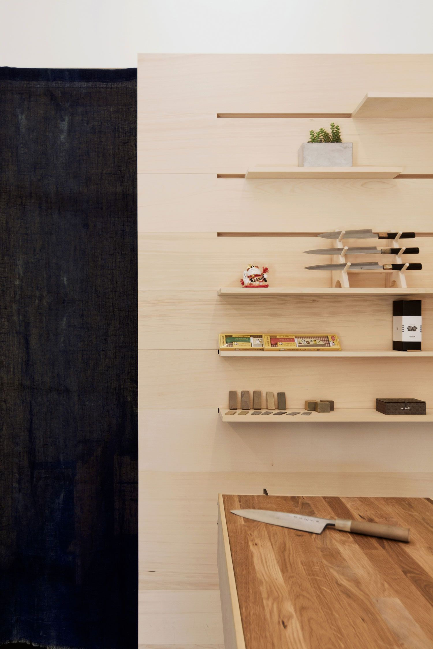 ai om knives shop in vancouver by scott and scott architects