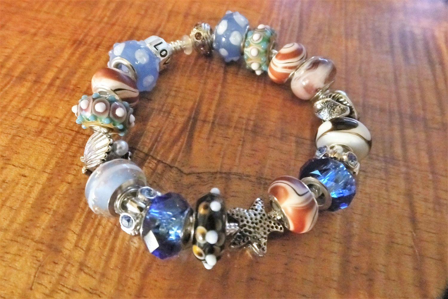Sandy Shores - A European Silver-Plated Charm Bracelet with charm pieces, of ocean blues, sandy browns, seashells starfish SS51516 by BlingItOutLoudCharms on Etsy