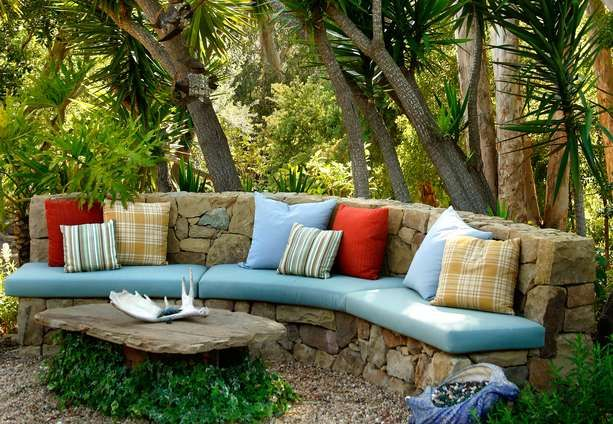 Natural stone bench with colorful cushions from Grace Design Associates.  (Photo credit: Lepere Studio)