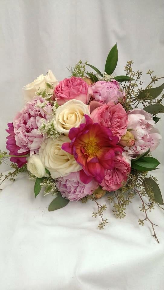 Beautiful pink flower bouquet made by countryside florist.   Wedding ...