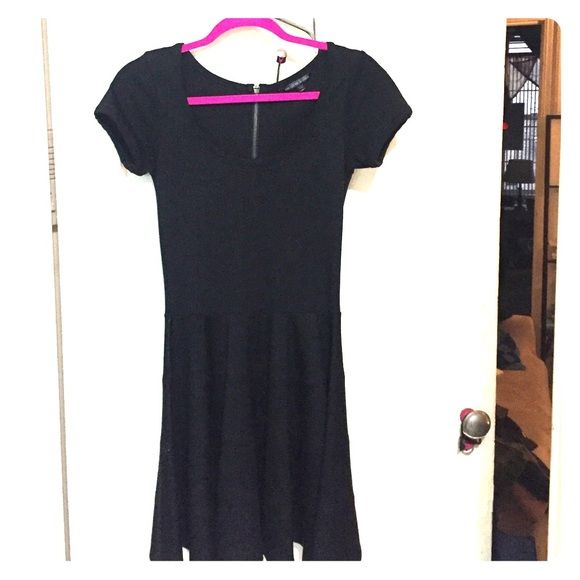 Black Dress Peplum style black short sleeve dress. Never worn! Zip up the back. Felicity & Coco Dresses Midi