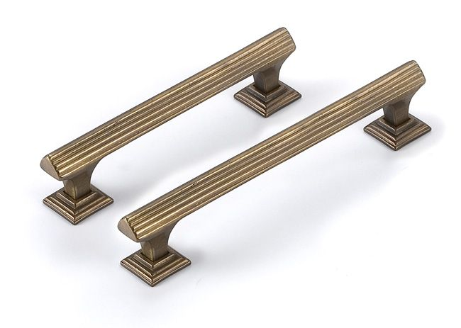 I love these brass pin pulls. Adds glam to any drawer. A