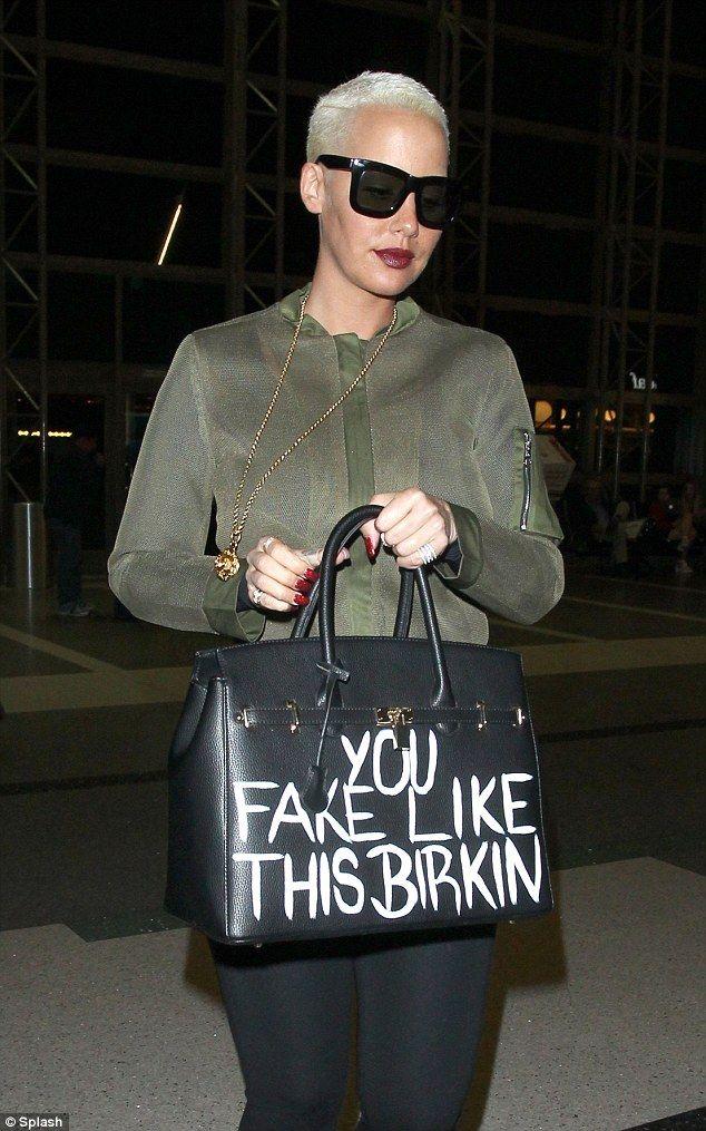 Amber Rose Shows Off Derriere In Skin Tight Jeans In London Birkin Bag Birkin Chanel Deauville Tote Bag