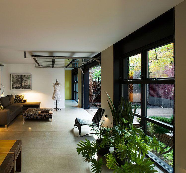 La maison en U située à Montréal est tout simplement magnifique avec