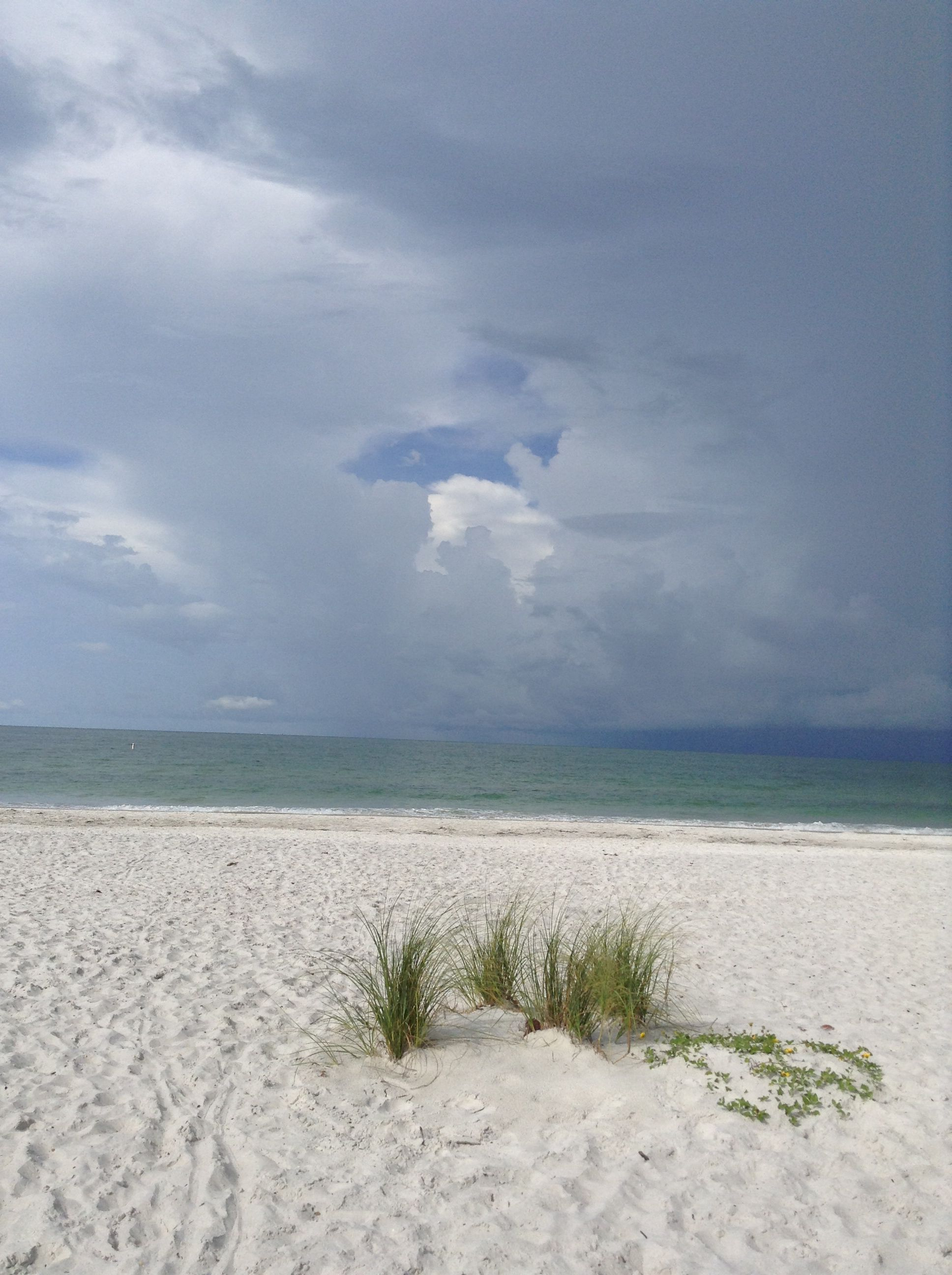 A calm before the storm. Even with a storm moving in the beach is awesome