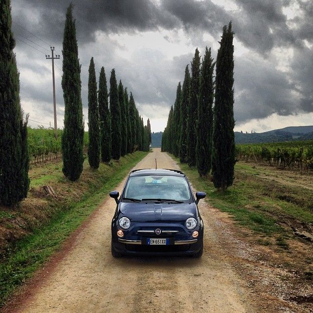 Grey skies and thunderstorms can be overcome with a smile! #Fiat500