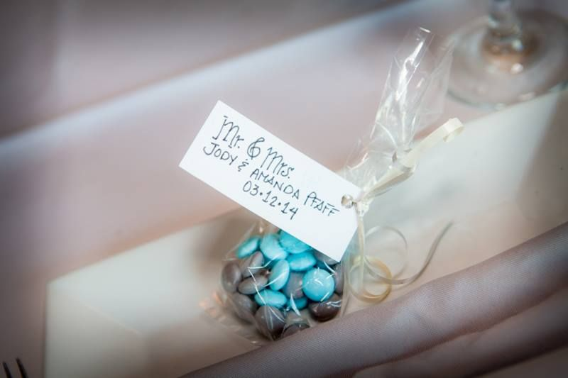 Personalized M&Ms are a great idea for favors #weddingfavors #candy #candyfavors  http://www.elegantweddingsoforlando.com Photo copyright: Matt Jylha Photography