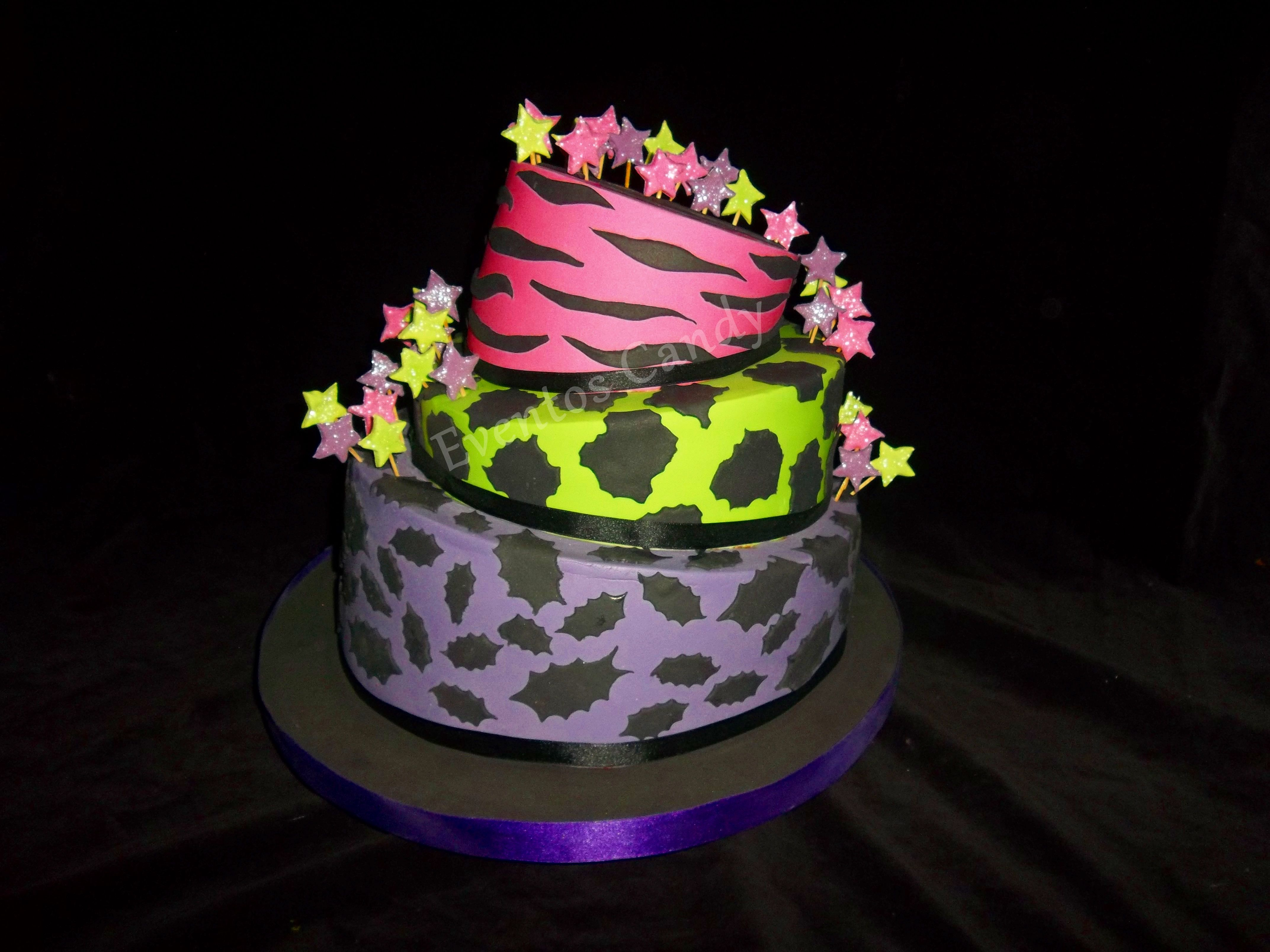 green violet and pink topsy turvy cake