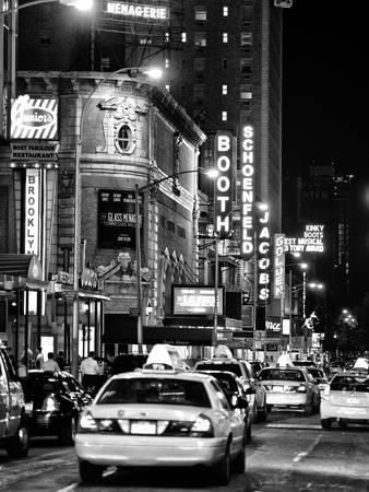 Urban Scene with Yellow Cab by Night at Times Square, Manhattan, NYC, Black and White Photography By Philippe Hugonnard