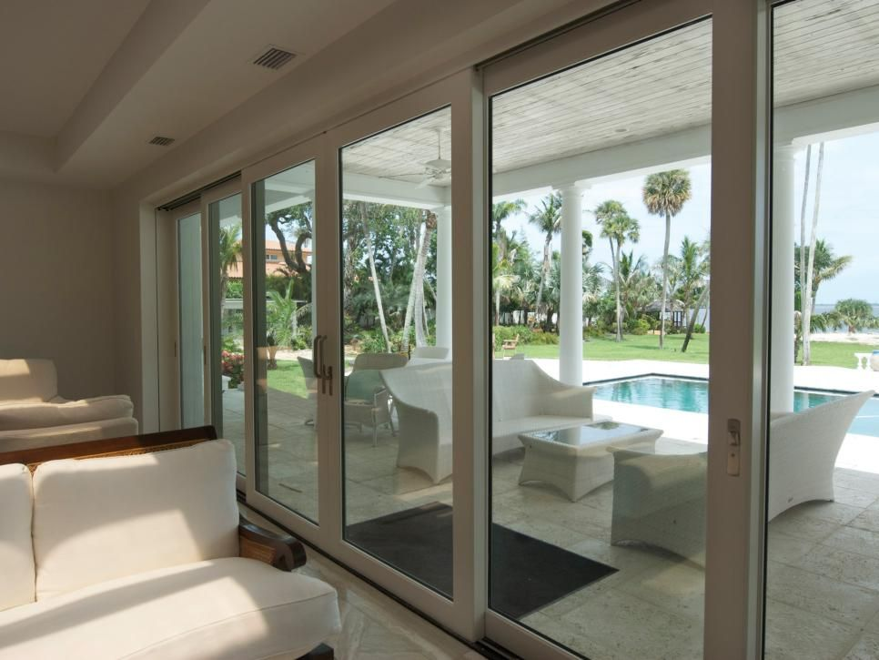 Open Your Interiors To The Great Outdoors By Incorporating Glass Walls Sliding Doors Or