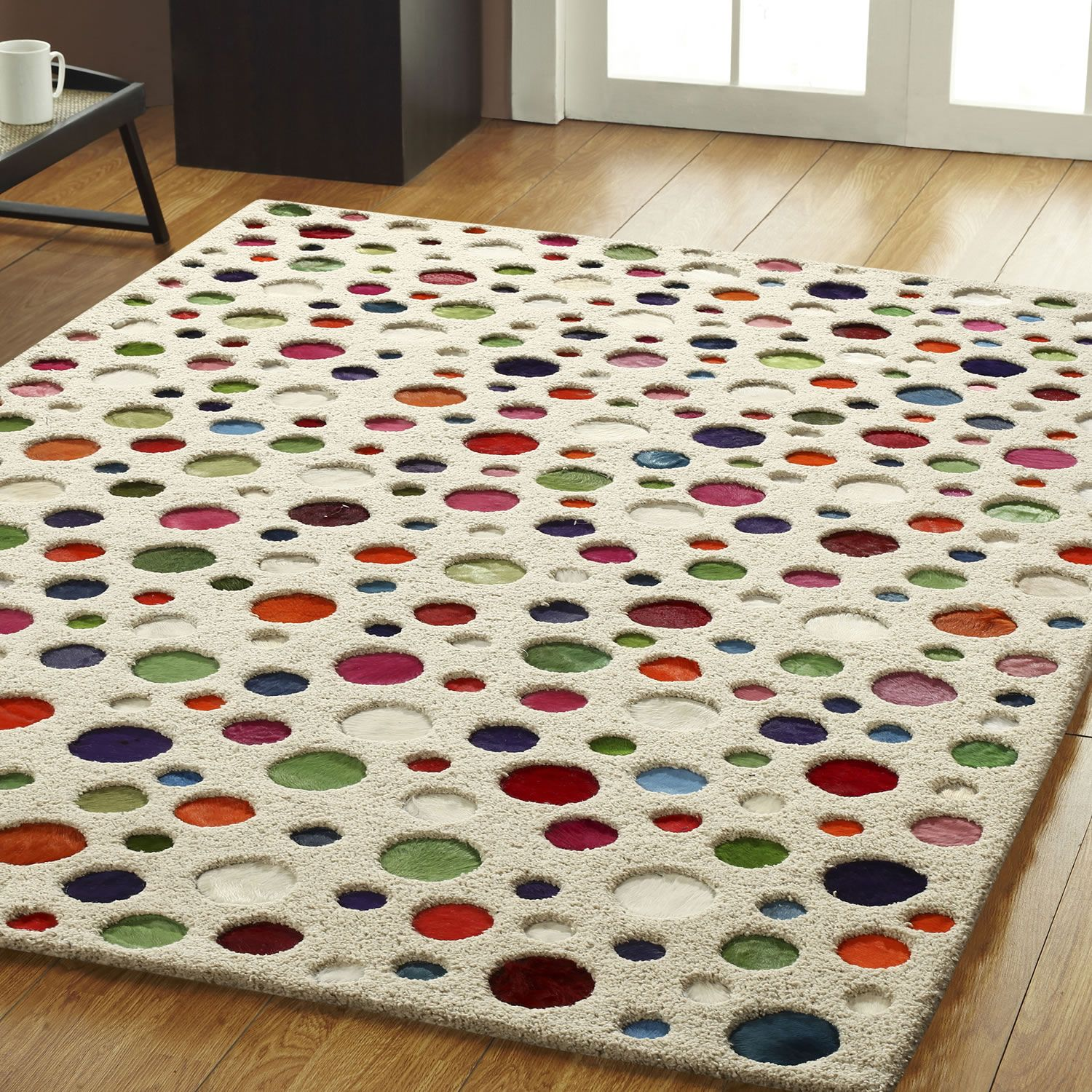 A fun and colourful rug with dyed, cow hide polka dots in