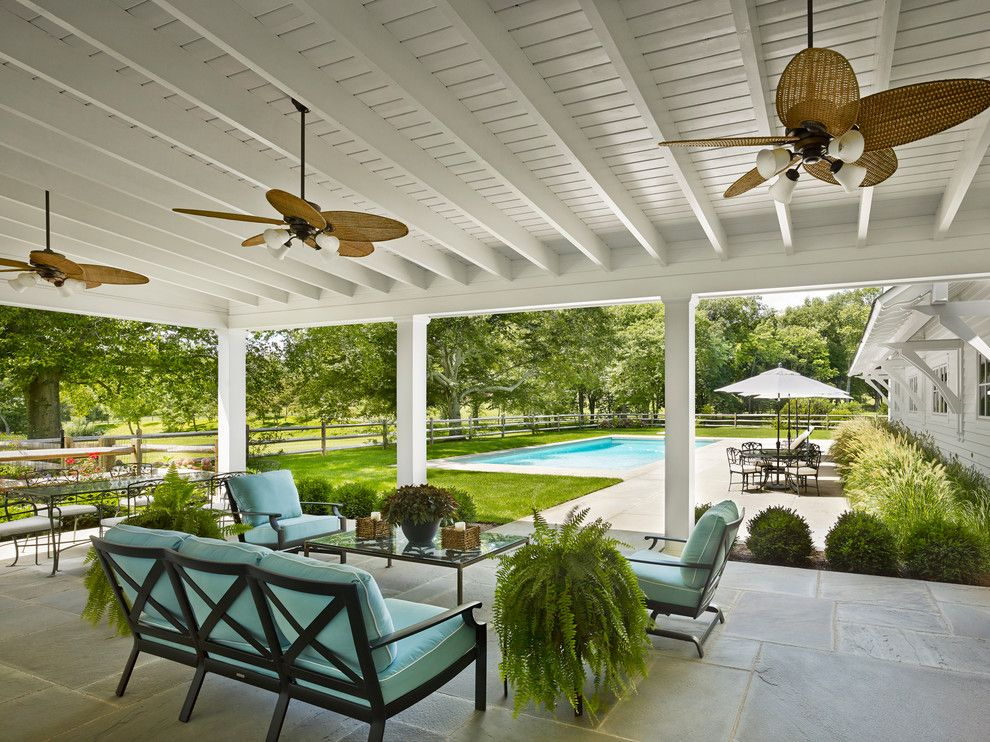 A Frame Patio Cover Farmhouse With White Ceiling Palm Frond Fan