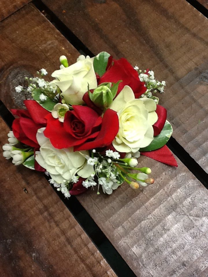 Small Red And White Spray Roses Make This A Stunning Corsage