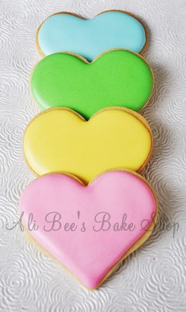 Icing consistency for sugar cookie decorating tutorial - love the simplicity of these hearts. Would be cute with sayings on them.