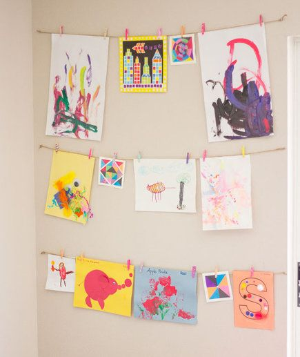 Art Wall   Instead of letting your child's drawings clutter your fridge door or countertops, hang a few artfully and don't feel guilty about tossing the others.