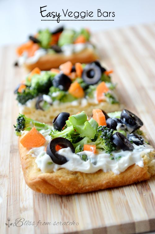 Easy Veggie Bars, flakey crescent roll crust, a layer of garlicy creaminess, and fresh crunchy veggies.  Crowd pleasing finger food!  | Bliss From Scratch