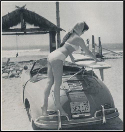 Girl putting surfboard on her Porsche 356 - cool